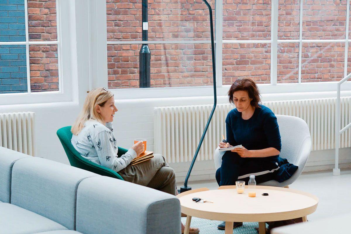 Two Women Sat In An Office
